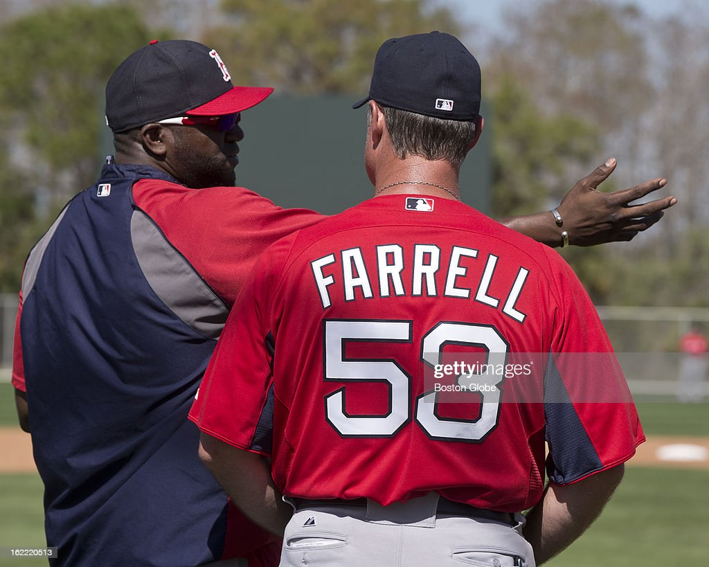 Boston Red Sox manager John Farrell talks to David Ortiz during spring training at JetBlue Park on Wednesday, Feb. 20, 2013.