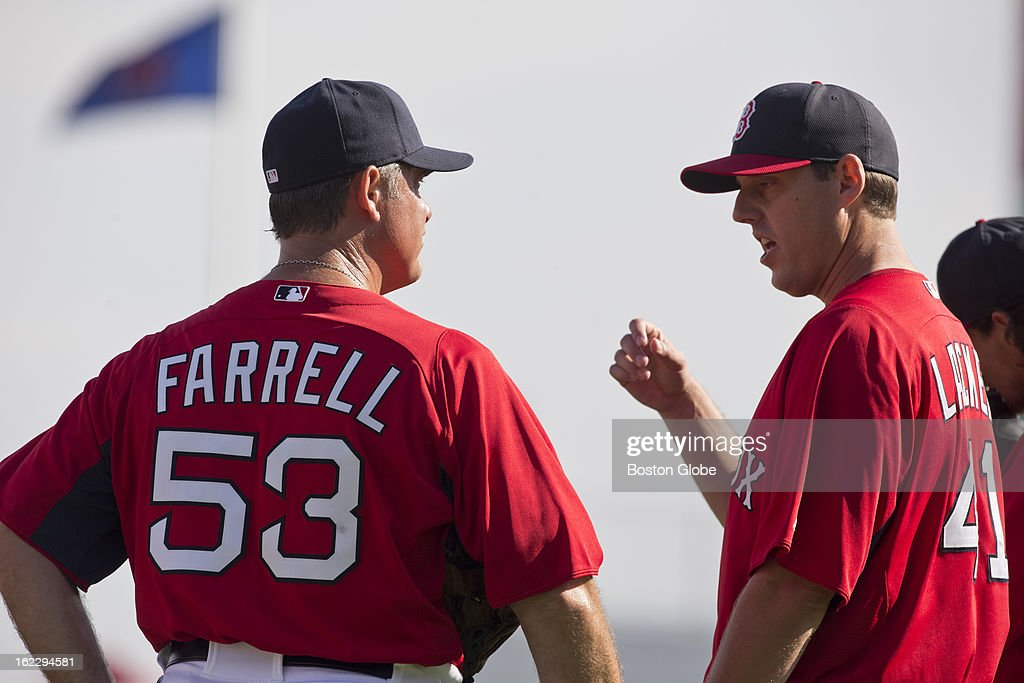 Boston Red Sox manager John Farrell talks to John Lackey before the start of their exhibition season opener during spring training at JetBlue Park on Thursday, Feb. 21, 2013.
