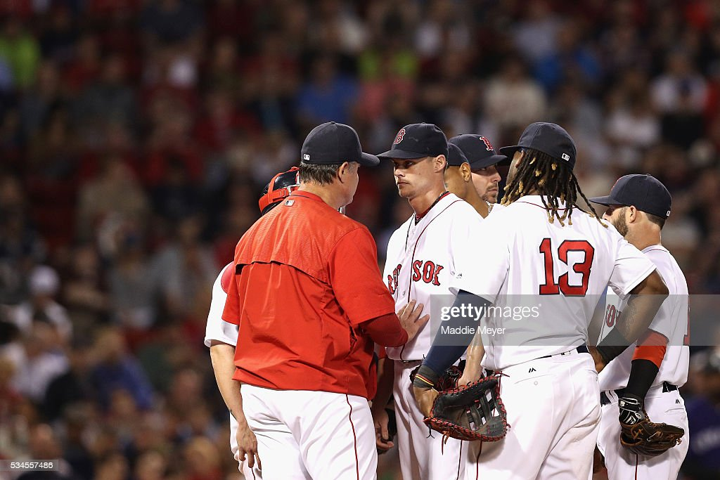 Boston Red Sox manager John Farrell talks with Clay Buchholz #11 of the Boston Red Sox during the fifth inning against the Colorado Rockies at Fenway Park on May 26, 2016 in Boston, Massachusetts.