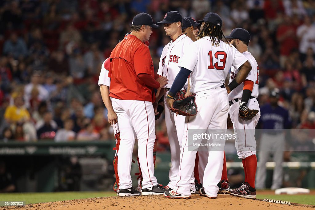Boston Red Sox manager <a gi-track='captionPersonalityLinkClicked' href=/galleries/search?phrase=John+Farrell+-+Baseball+Manager&family=editorial&specificpeople=10307520 ng-click='$event.stopPropagation()'>John Farrell</a> talks with <a gi-track='captionPersonalityLinkClicked' href=/galleries/search?phrase=Clay+Buchholz&family=editorial&specificpeople=4424901 ng-click='$event.stopPropagation()'>Clay Buchholz</a> #11 of the Boston Red Sox during the fifth inning against the Colorado Rockies at Fenway Park on May 26, 2016 in Boston, Massachusetts.