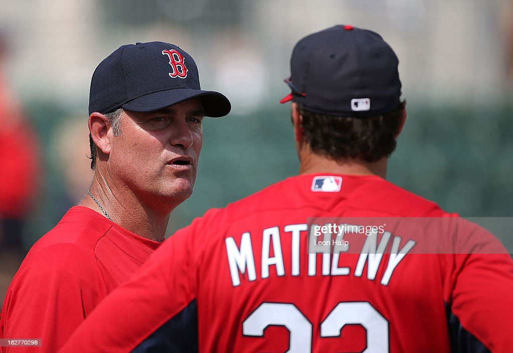 Boston Red Sox Manager John Farrell #53 talks with St. Louis Cardinals manager Mike Matheny #22 prior to the start of the game at JetBlue Park on February 26, 2013 in Fort Myers, Florida.