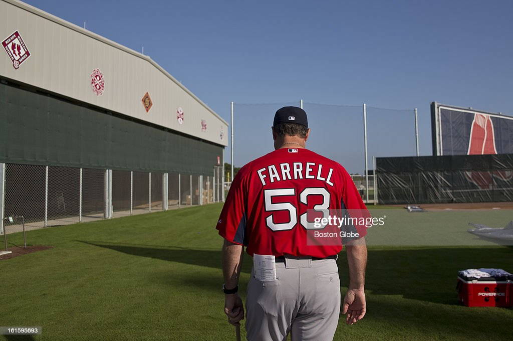 Boston Red Sox manager John Farrell walks onto the field during the first official spring training day for the Boston Red Sox pitchers and catchers at JetBlue Park on Tuesday, Feb. 12, 2013.