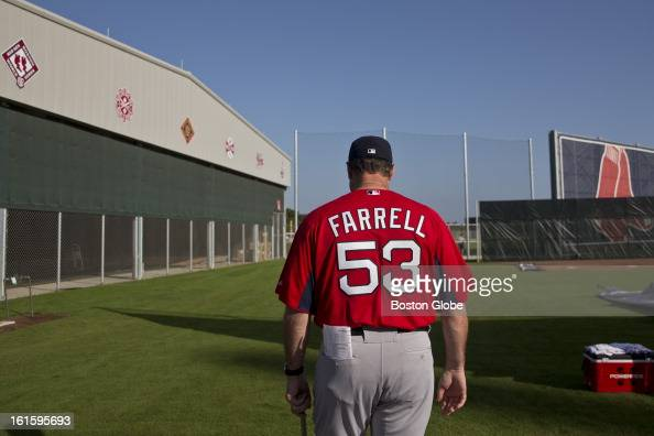 Boston Red Sox manager John Farrell walks onto the field during the first official spring training day for the Boston Red Sox pitchers and catchers...