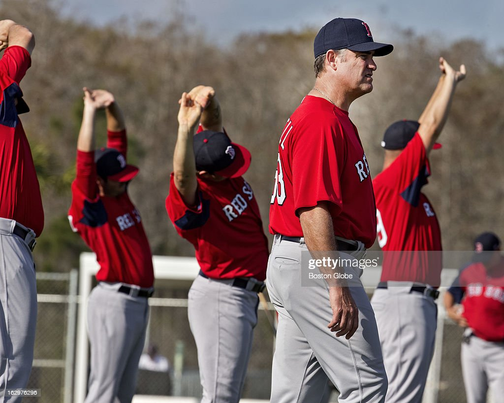 Boston Red Sox manager John Farrell walks through the team's morning stretching session during spring training at their training facilities at JetBlue Park on Wednesday, Feb. 13, 2013.