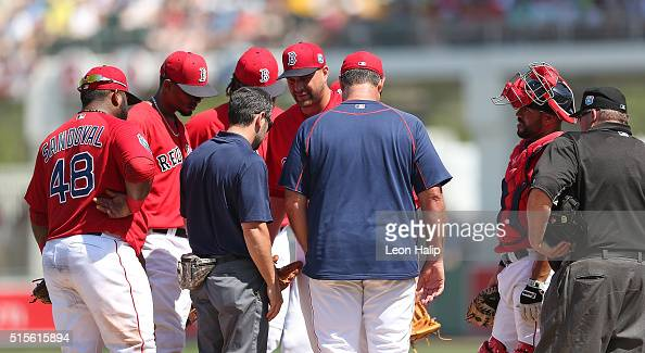 Boston Red Sox manager John Farrell walks to the mound to tale with pitcher Brian Johnson during the fifth inning of the Spring Training Game against...