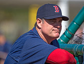 Boston Red Sox Manager John Farrell watches batting practice at Fenway South on February 21 2015 in Fort Myers Florida