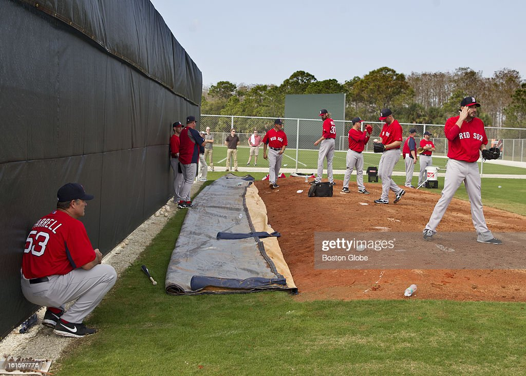 Boston Red Sox manager John Farrell watches his pitchers work out during the first official spring training day for the Boston Red Sox pitchers and catchers at JetBlue Park on Tuesday, Feb. 12, 2013.