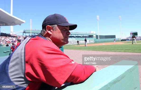 Boston Red Sox Manager John Farrell watches the action from the dugout during the game against the Baltimore Orioles at JetBlue Park at Fenway South...