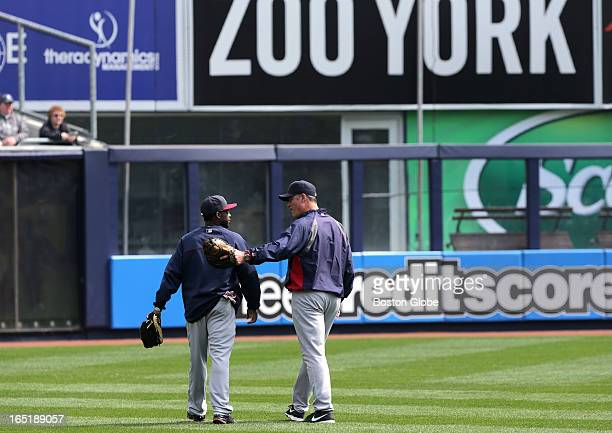 Boston Red Sox manager John Farrell welcomes Boston Red Sox left fielder Jackie Bradley to ZOO YORK and left field as the Red sox take the field for...
