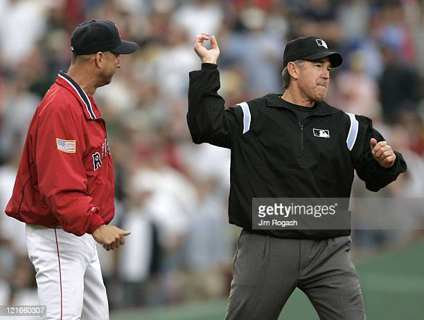 Boston Red Sox manager Terry Francona left is thrown out after argueing a call with umpire Mike Winters in a game against the New York Yankees at...