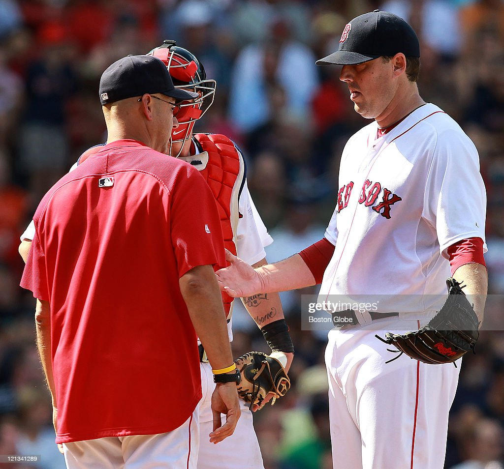 Boston Red Sox manager Terry Francona (47) takes the ball from Boston Red Sox starting pitcher John Lackey (41) in the seventh inning. The Boston Red Sox took on the Tampa Bay Rays in Game 3 of a 3 game series at Fenway Park.