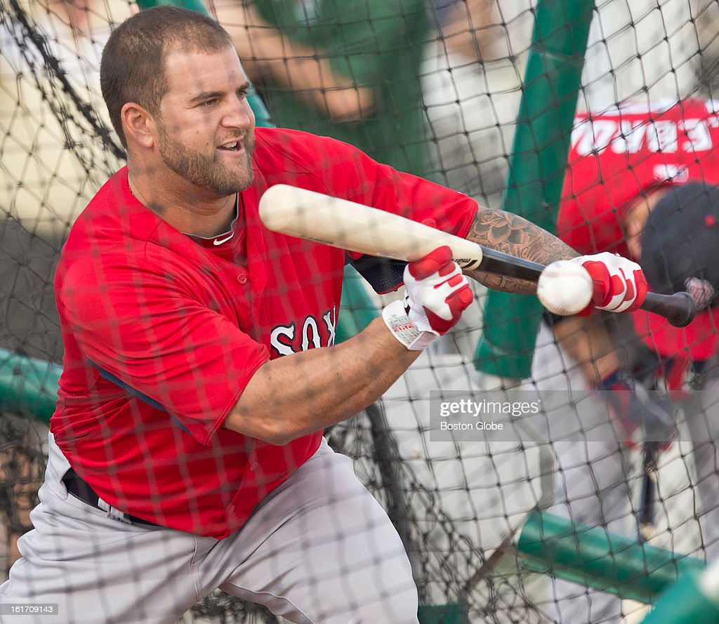 Boston Red Sox Mike Napoli puts down a bunt. Day two of spring training at the Red Sox training facilities at JetBlue Park on Wednesday, Feb. 13, 2013.