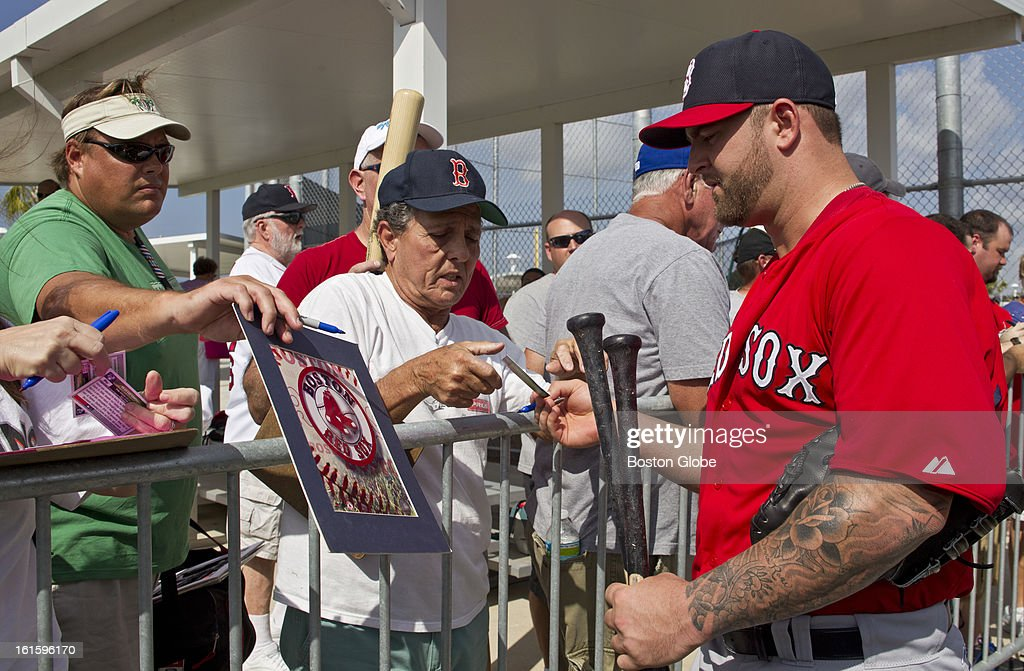 Boston Red Sox Mike Napoli signs his autograph after the first official spring training day for the Boston Red Sox pitchers and catchers at JetBlue Park on Tuesday, Feb. 12, 2013.
