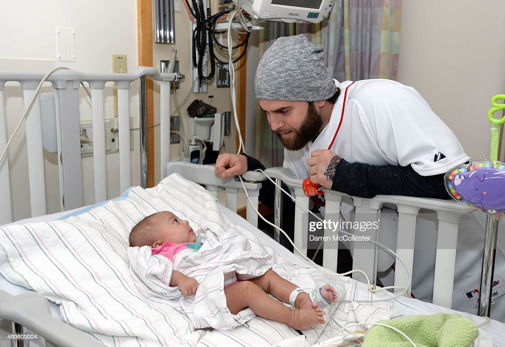 Boston Red Sox Mike Napoli spreads cheer with New Balance to Jada at Boston Children's Hospital December 17 2014 in BostonMassachusetts