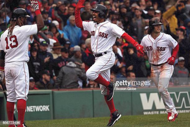 Boston Red Sox Mookie Betts celebrates with Boston Red Sox designated hitter Hanley Ramirez and Boston Red Sox left fielder Andrew Benintendi after...