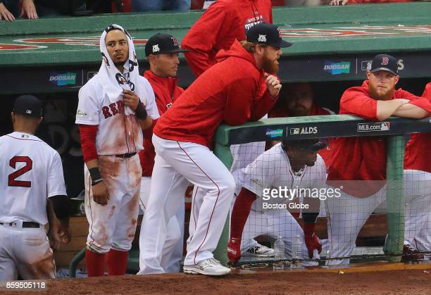 Boston Red Sox Mookie Betts has a towel on his head a he stands with teammates in the 9th inning with two outs The Boston Red Sox hosted the Houston...