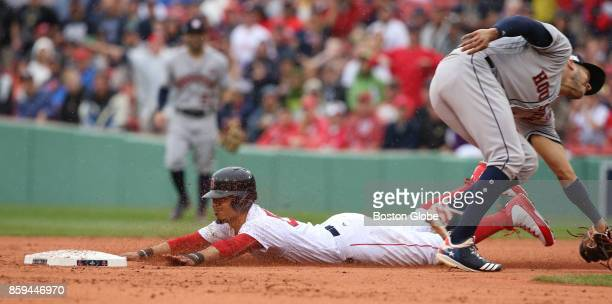 Boston Red Sox Mookie Betts steals second base against Astros Carlos Correa in the first inning The Boston Red Sox host the Houston Astros in Game...