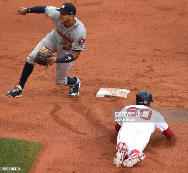 Boston Red Sox Mookie Betts steals to second base against Astros Carlos Correa in the first inning The Boston Red Sox host the Houston Astros in Game...