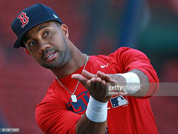 Boston Red Sox outfielder Chris Young demonstrates something to a teammate around the batting cage during a workout at Fenway Park in Boston on Oct 4...
