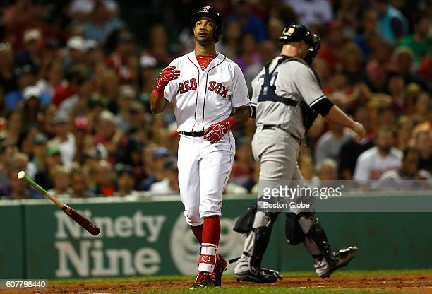 Boston Red Sox outfielder Chris Young reacts after striking out to end the first inning against the New York Yankees at Fenway Park in Boston on Sept...