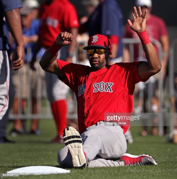 Boston Red Sox outfielder Chris Young slides into the bag during a sliding drill on day eight of Red Sox Spring Training at Jet Blue Park in Fort...