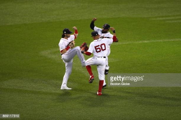 Boston Red Sox outfielders Andrew Benintendi left Jackie Bradley Jr rear right and Mookie Betts center celebrate after the Red Sox defeated the...