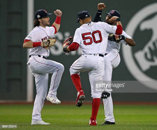 Boston Red Sox outfielders Andrew Benintendi Mookie Betts and Jackie Bradley Jr celebrate Boston's 103 victory over the Houston Astros The Boston Red...