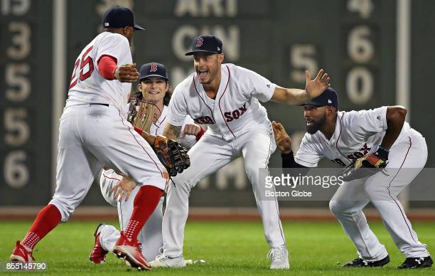 Boston Red Sox outfielders Rajai Davis Andrew Benintendi and Jackie Bradley Jr right are joined by relief pitcher Joe Kelly center as he runs into...