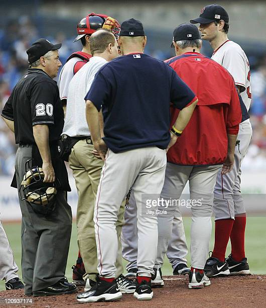 Boston Red Sox P Matt Clement consults with Manager Terry Francona and other personnel regarding an undisclosed ailment during tonight's game vs the...