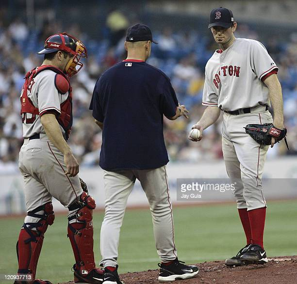 Boston Red Sox P Matt Clement hands the ball to Manager Terry Francona after giving up 6 runs in less than 4 innings during tonight's game vs the...