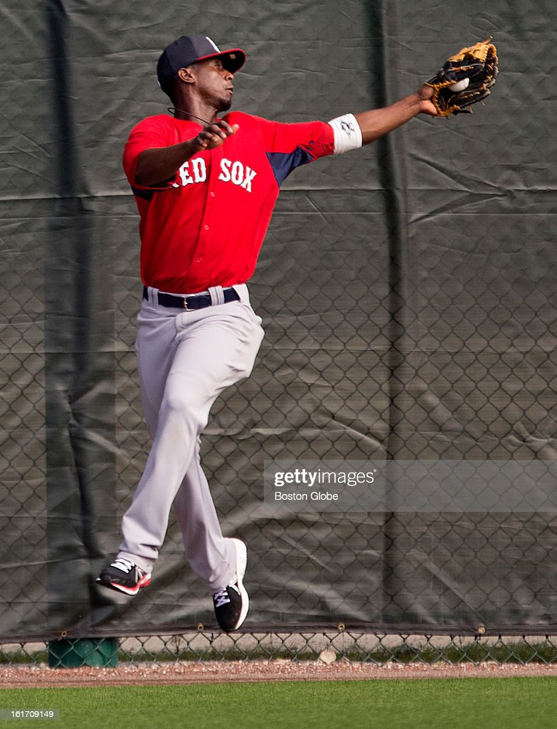 Boston Red Sox Pedro Ciriaco makes a leaping catch. Day two of spring training at the Red Sox training facilities at JetBlue Park on Wednesday, Feb. 13, 2013.