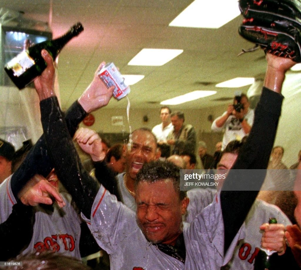 Boston Red Sox <a gi-track='captionPersonalityLinkClicked' href=/galleries/search?phrase=Pedro+Martinez&family=editorial&specificpeople=171773 ng-click='$event.stopPropagation()'>Pedro Martinez</a> is sprayed with champagne in the locker room by teammates after they defeated the Cleveland Indians 11 October 1999 in game five of the American League Championship Series in Cleveland, OH. The Red Sox defeated the Indians 12-8, to advance to the American League Championship Series against the New York Yankees. AFP PHOTO Jeff KOWALSKY