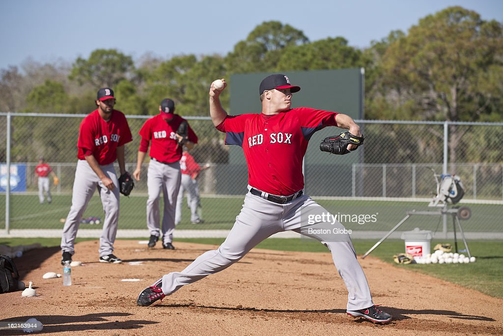 Boston Red Sox pitcher Andrew Bailey throws in the bull pen during spring training at JetBlue Park on Tuesday, Feb. 19, 2013.