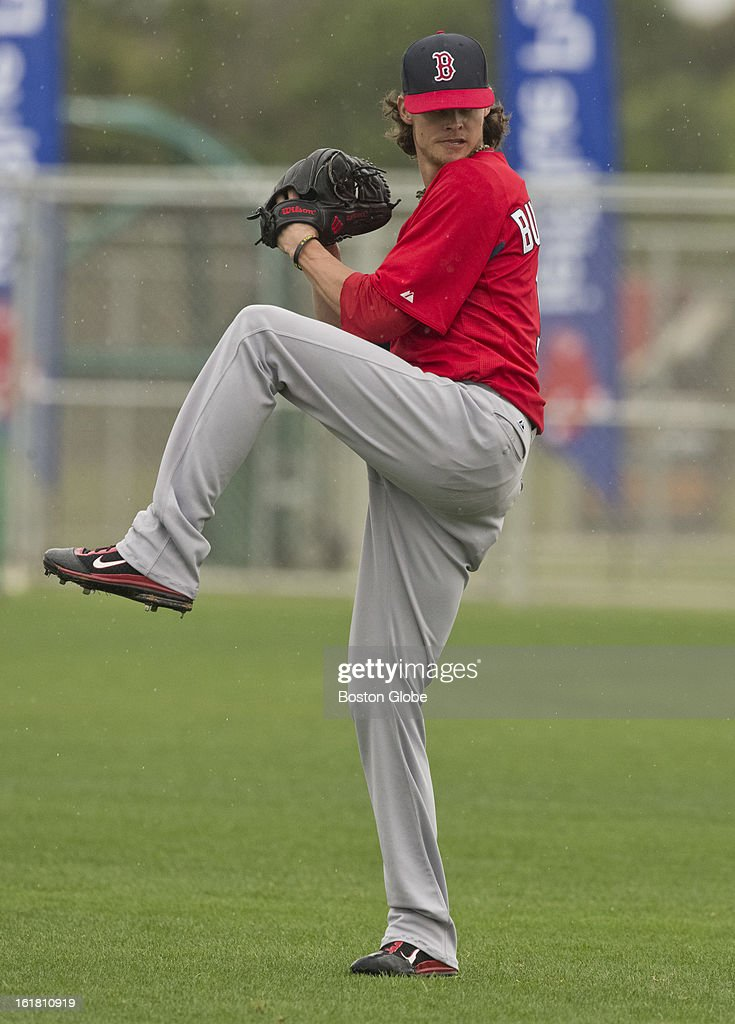 Boston Red Sox pitcher Clay Buchholz throws in the outfield on a practice field during first full squad team workout. Day four of spring training at the Red Sox training facilities at JetBlue Park on Friday, Feb. 15, 2013.