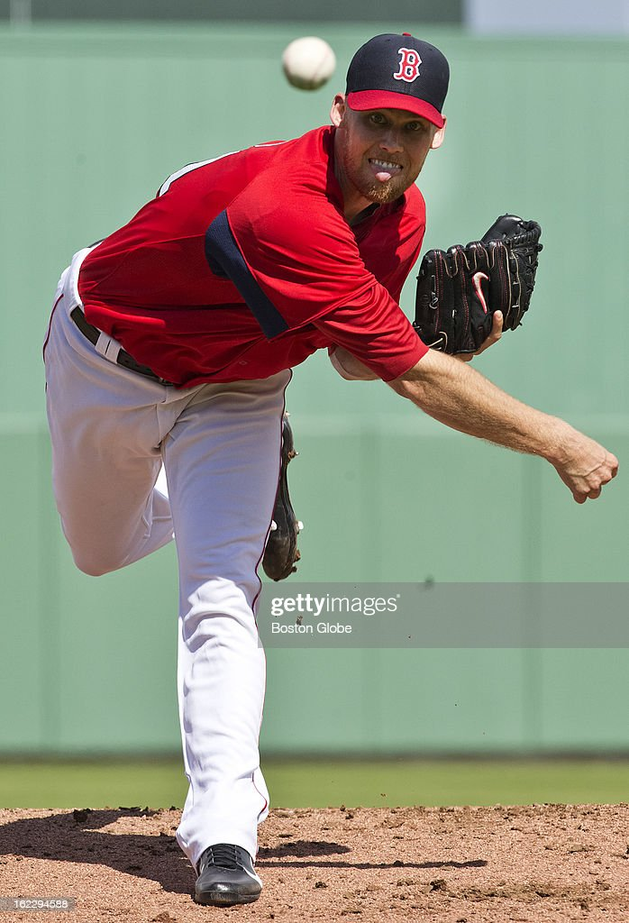 Boston Red Sox pitcher Daniel Bard watches the flight of his pitch against Northeastern University in the exhibition season opener during spring training at JetBlue Park on Thursday, Feb. 21, 2013.