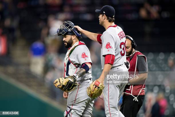 Boston Red Sox pitcher Doug Fister taps Boston Red Sox catcher Sandy Leon on the helmet following the Major League Baseball game between the Boston...