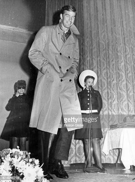 Boston Red Sox pitcher Jim Lonborg models a Bill Blass midi coat with doublebreasted styling during a fashion show organized by Red Sox wives to...