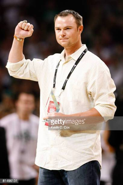 Boston Red Sox pitcher Jon Lester is introduced during a break in the game between the Los Angeles Lakers and the Boston Celtics in Game Two of the...