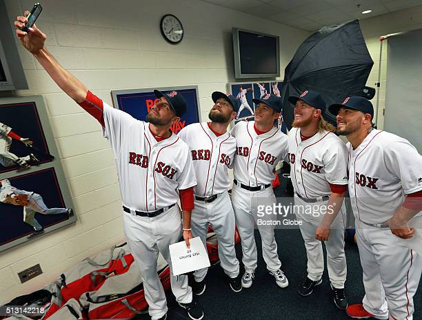 Boston Red Sox pitcher Matt Barnes far left takes a selfie with teammates from left Bryce Brentz Josh Rutledge Robbie Ross Jr and Ali Solis during...