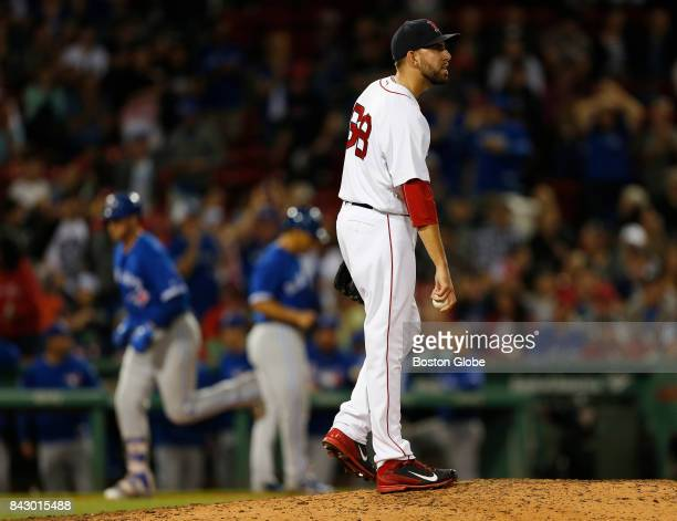 Boston Red Sox pitcher Matt Barnes reacts after giving up a run to the Blue Jays' Justin Smoak left during the ninth inning The Boston Red Sox host...