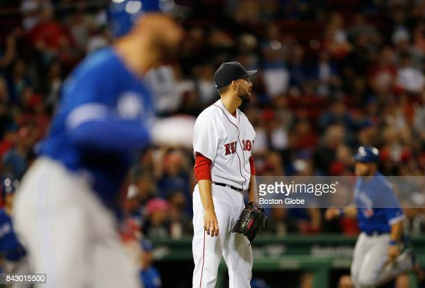 Boston Red Sox pitcher Matt Barnes reacts after giving up a run to the Blue Jays during the ninth inning The Boston Red Sox host the Toronto Blue...