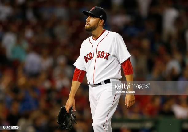 Boston Red Sox pitcher Matt Barnes reacts as he walks back to the dugout after being taken out of the game after giving up three runs to the Blue...