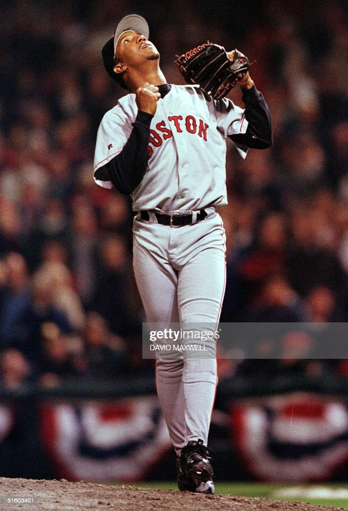 Boston Red Sox pitcher Pedro Martinez reacts after Cleveland Indians short stop Omar Vizquel grounded out for the final out of of game five of the...