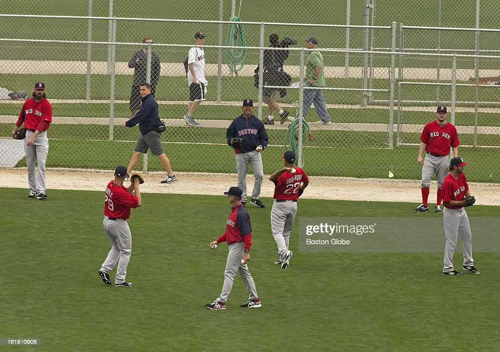 Boston Red Sox pitchers throw during the first full squad team workout. Day four of spring training at the Red Sox training facilities at JetBlue Park on Friday, Feb. 15, 2013.