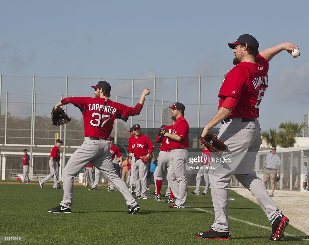 Boston Red Sox pitchers warming up. Day two of spring training at the Red Sox training facilities at JetBlue Park on Wednesday, Feb. 13, 2013.