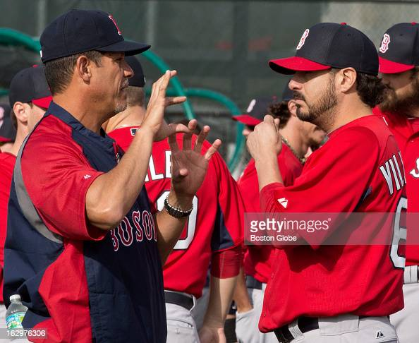 Boston Red Sox pitching coach Juan Nieves left talks to righthanded pitcher Oscar Villarreal during spring training at JetBlue Park on Saturday Feb...