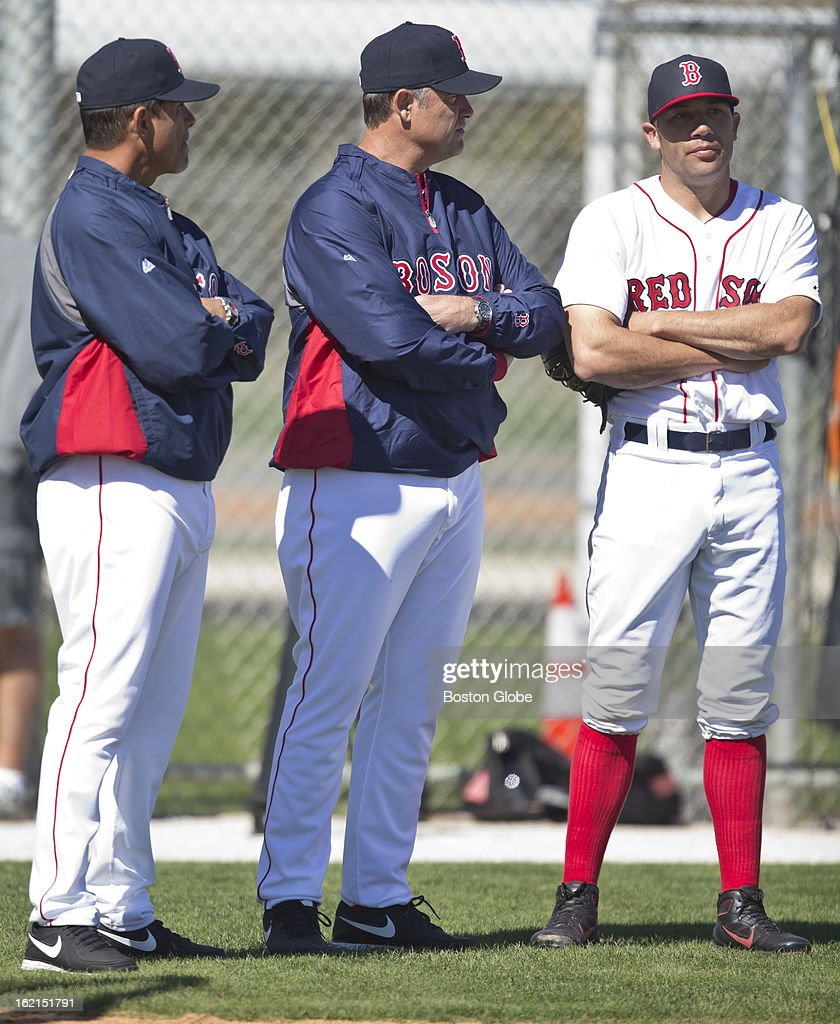 Boston Red Sox player Alfredo Aceves, right, explains to manager John Farrell, middle, and pitching coach Juan Nieves why he threw live batting practice with no velocity on his pitches during a Red Sox spring training workout at JetBlue Park on Sunday, Feb. 17, 2013.