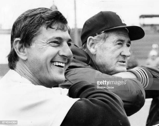 Boston Red Sox player Carl Yastrzemski left and former player Ted Williams look on during Red Sox Spring Training in Winter Haven FL on Mar 1 1983