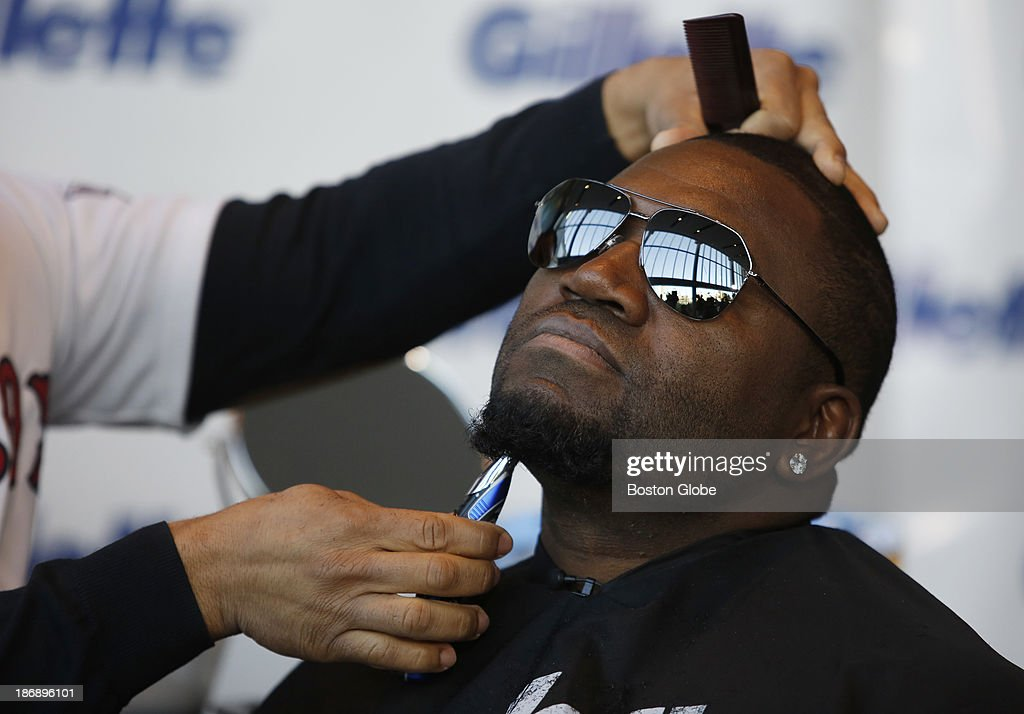 Boston Red Sox player David Ortiz has his beard shaved off at Gillette World Shaving Headquarters in Boston on November 4, 2013. Gillette donated $100,000 to the One Fund Boston after the shave.