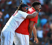 Boston Red Sox player David Ortiz right and designated hitter Hanley Ramirez celebrate the Red Sox 87 win over the Minnesota Twins at Fenway Park in...